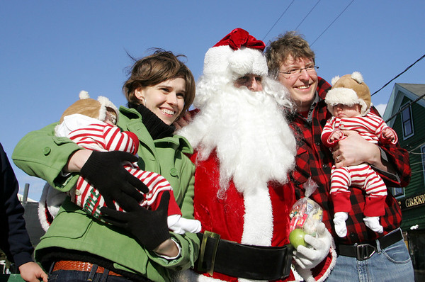 Rockport: Molly and Josh Tompkins and their twin girls Karoline and Rory, 3 months, pose for a picture with Santa at Dock Square Christmas morning.  <br /> Photo by Mary Muckenhoupt/Gloucester Daily Times Thursday, December 25, 2008
