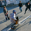 Gloucester: Terrance Lane, left, Joey Ciolino, center, and Vincenzo Terranova, right, take shots on Michael Russo while playing street hockey on Beauport Avenue Tuesday afternoon. Photo by Kate Glass/Gloucester Daily Times Tuesday, December 30, 2008