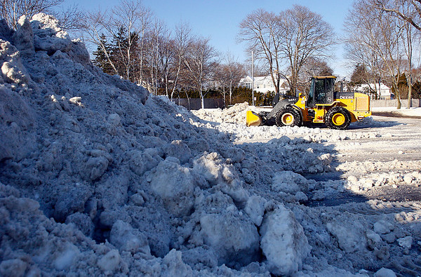 Manchester: Crews remove snow from the parking lot at Singing Beach in Manchester yesterday. Photo by Kate Glass/Gloucester Daily Times Monday, December 22, 2008