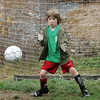 Gloucester:  Roman Gadbois, 9, of Gloucester blocks the goal after his friend Joseph Kibango kicks the ball as the boys play after their youth soccer game at Kettle Cove Field Saturday afternoon.  Mary Muckenhoupt/Gloucester Daily Times