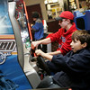 Gloucester: Joe Marcantonio, 11, right, and Aaron Dahlmer, 15, play a race car video game during half time of the Gloucester vs. Duxsbury Super Bowl game which was being shown at Gloucester Cinema Saturday evening. Mary Muckenhoupt/Gloucester Daily Times