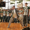 Manchester: Robbie Bilsbury, a teacher at Manchester Essex High School, dressed up as Matt Foley, a motivational speaker from Saturday Night Live, to give some words of advice to the Hornet's before their Super Bowl game at Gillette Stadium tomorrow.  A pep rally was held for the football team in the school's gymnasium at the end of the school day giving the team a proper send off before their big game. Also pictured principal Paul Murphy and football captains Clayton Morrissey and Pat Orlando, right. Mary Muckenhoupt/Gloucester Daily Times