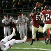 Gloucester's Robbie Lowe celebrates his interception with teammate Marc Alves as Masconomet's Evan Bunker lies on the ground during their Division 2A playoff game at Manning Field in Lynn last night. Photo by Kate Glass/Gloucester Daily Times Tuesday, December 2, 2008