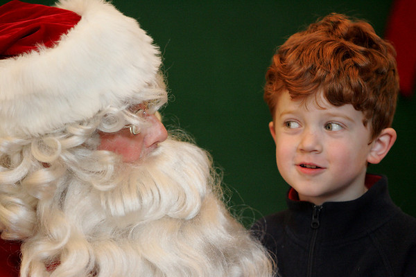 Manchester: Nicholas Holt-Doucette, 5, tells Santa what he wants for Christmas at the Manchester Community House Saturday afternoon.  The one big item Nicholas asked for was a camera. Mary Muckenhoupt/Gloucester Daily Times