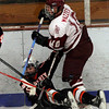 Gloucester: Gloucester's Keith Mazzeo trips up Beverly's Brenden Mitchell during their game in the Cape Ann Savings Bank Holiday Tournament at the Talbot Rink last night. Photo by Kate Glass/Gloucester Daily Times Monday, December 29, 2008