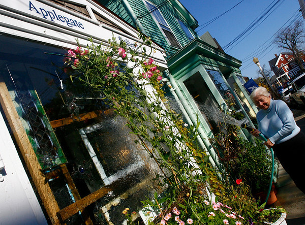 Rockport: Pat Pierce waters flowers outside the Applegate Gallery in Rockport. She planted the flowers in late August and several are just starting to bloom, keeping summer around for a few extra weeks. Photo by Kate Glass/Gloucester Daily Times Monday, October 27, 2008