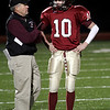 Gloucester football coach Paul Ingram talks with quarterback Rick Gallant before a play in their Division 2A playoff game at Manning Field in Lynn last night. Photo by Kate Glass/Gloucester Daily Times Tuesday, December 2, 2008