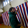 Rockport: Chuck Osmond adjusts the curtains as he sets up voting booths at Rockport Elementary School yesterday. Students and teachers will not report to school due to the expected high voter turnout and safety concerns. Photo by Kate Glass/Gloucester Daily Times Monday, November 3, 2008