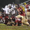 Gloucester:  Gloucester's Robert Lowe takes down Lynn English QB Jesse Fowler for a loss of yards, last night at  Newell Stadium .  Photo by Desi Smith/Gloucester Daily Times Friday, November 7, 2008