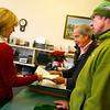 Gloucester: Timothy Evans, center, and John O'Hara, right, submit more signatures for their petition asking the Gloucester City Council to rescind its vote on the Gloucester Crossings TIF proposal to Suzanne Egan, Gloucester city solicitor, at City Hall yesterday. Photo by Kate Glass/Gloucester Daily Times Monday, December 29, 2008