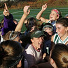 Manchester: The Manchester Essex field hockey team celebrates with their coach Pam Grant, center, after their victory against Wayland at Coach Ed Field Field Friday afternoon.  Manchester Essex defeated Wayland  1-0 alowing the Horents to move on to the Diviosion 2 north semi finals. Mary Muckenhoupt/Gloucester Daily Times
