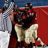 Gloucester's Rick Gallant, Giacomo Romeo, and Andrew Porper celebrate Romeo's touchdown in the third quarter of the Division 2A Super Bowl game against Duxbury at Gillette Stadium on Saturday. The Fishermen lost 46-26. Photo by Kate Glass/Gloucester Daily Times Saturday, December 6, 2008