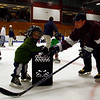 Gloucester: Steve Militello, GHS hockey assistant coach, helps Chase Sargent, 2, around Talbot Rink during family night for Cape Ann Youth Hockey last night. Kids skated with members of the high school teams, learned skills, and participated in other games and raffles. Photo by Kate Glass/Gloucester Daily Times