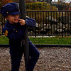 "Spencer Brancaleone, 3, contemplates his next move while climbing around the Benjamin Smith Playground on East Main Street yesterday. Spencer loved his police officer costume so much he has worn it every day since Halloween. ""He's not sleeping in it anymore, so that's an improvement"" his mom said."