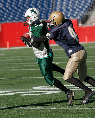 Manchester Essex's Colin Lyne tips a pass intended for Tri-County's Mike Foster during their Division 4 Super Bowl game at Gillette Stadium on Saturday. Pat Orlando picked up the ball for the interception. Photo by Kate Glass/Gloucester Daily Times Saturday, December 6, 2008