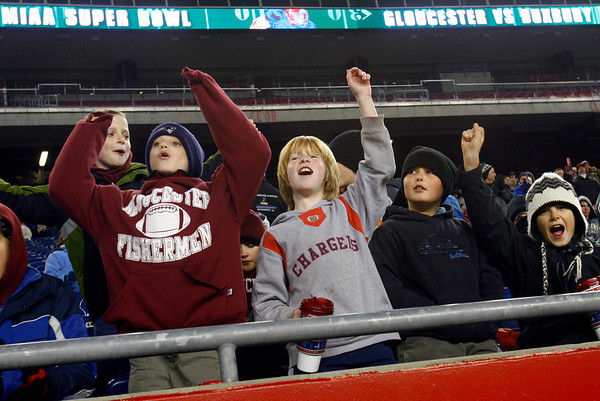 From left: Jon Sawyer, Patrick Goss, Andrew Latassa, Brett Lovasco, and Cormac Flickinger, all 10, cheer on the Gloucester Fishermen as they play Duxbury in the Division 2A Super Bowl at Gillette Stadium on Saturday. The Fishermen lost 46-26. Photo by Kate Glass/Gloucester Daily Times Saturday, December 6, 2008