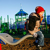 Rockport: Christopher Cucchiaro, 5, left, watches as his twin brother, Matthew, climbs on the end of a seesaw at the new Amelia Grace Place behind Rockport Elementary School. The two braved frigid temperatures for a few minutes of play time. Photo by Kate Glass/Gloucester Daily Times Monday, December 8, 2008