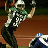 Manchester: Manchester Essex's Brian Ciccone puts his hands up after receiving a 17 yard touchdown pass from Pat Orlando during the Division 4 football playoff game held at Reading High School Tuesday night.  Manchester Essex defeated O'Bryant 29-21. <br /> Photo by Mary Muckenhoupt/Gloucester Daily Times Tuesday, December 02, 2008