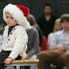 Manchester: Michael Murphy, 4, sits and listens to the high school band play Christmas songs during the holiday concert at Manchester Essex High School Friday morning.  Michael came to work with his father, vice principal Paul Murphy, and stayed close to dad the whole concert.  Mary Muckenhoupt/Gloucester Daily Times