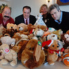 Gloucester: Rotary Club members bring in teddy bears that will be given to children at scenes of domestic cases and others.  From left to right, Rotary Club member Tony Corrao, Chief of Police John Beaudette, Rotary Club President Sinikka Nogelo and club member Josh Arnold at the Elks Club. Staff Photo/ The Gloucester Times<br /> December 9, 2008