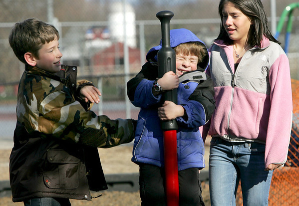 Rockport: John Paul Penaloza, 6, holds on tight as Stephen Grier, 10, and Shelby Salas, 12, give him a good spin while playing on the new playground called the Amelia Grace Place behind Rockport Elementary School Thursday after school was released.  Mary Muckenhoupt/Gloucester Daily Times