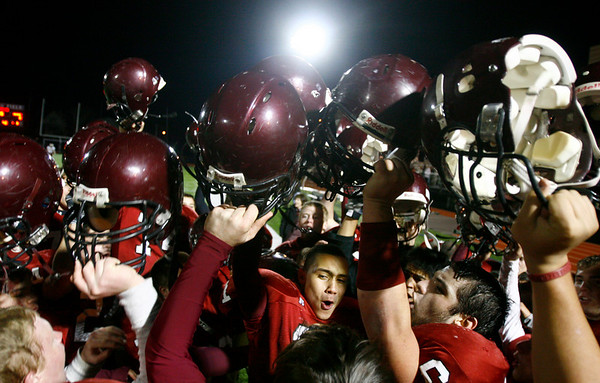 Members of the Gloucester football team celebrate their 26-7 victory over Masconomet in the Division 2A playoffs at Manning Field in Lynn yesterday. Photo by Kate Glass/Gloucester Daily Times Tuesday, December 2, 2008