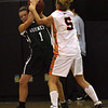 Ipswich: Manchester Essex's Lizzy Ball steals the ball away from Beverly's Jess Shaw during the finals of the Institution for Savings 2008 Invitational at Ipswich High School last night. Photo by Kate Glass/Gloucester Daily Times Tuesday, December 30, 2008