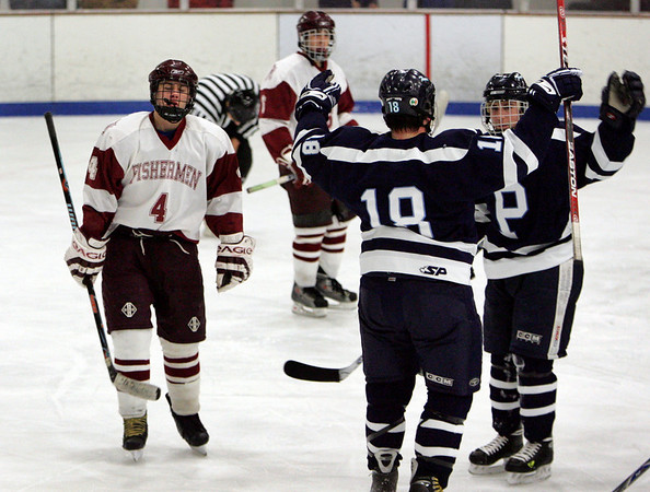 Gloucester: Gloucester Ben Favazza skates back to the bench as Peabody's Pete Sucharewicz and Mike Roughton, right, celebrate Peabody's forth goal during the Gloucester vs. Peabody hockey game at Dorothy Talbot Rink Wednesday night. Mary Muckenhoupt/Gloucester Daily Times