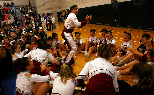 Woburn: Filippo Zappa applauds as the Gloucester High School Cheerleaders are announced as winners of the coed division in the North Regionals at Woburn High School yesterday. <br /> Photo by Kate Glass/Gloucester Daily Times Sunday, November 16, 2008
