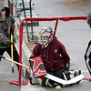 Gloucester: From left Terrance Lane, 11, Michael Russo, 14, and Coltyn Rivas, 14, play a game of street hockey on Beauport Avenue Friday afternoon.  The boys didn't seem to mind the light drizzle and said they play street hockey almost everyday.  Mary Muckenhoupt/Gloucester Daily Times.