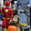 Manchester: Will Kent, 22 months, looks at the candy he collected while wearing his monkey suit during the Wobblin' Goblin parade Saturday morning. Children paraded through town from Town Hall to the Community Center gathering treats along the way. Mary Muckenhoupt/Gloucester Daily Times