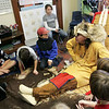 Gloucester: Dan Cripps of Native American Perspectives talks to kids at the Eastern Point Day School about how Native Americans used to disguise themselves as other animals when hunting.  Cripps dressed in clothing of the western plains of the 1800s and talked about Native American culture and early American history on Saturday from 10 a.m. to 1 p.m.  Mary Muckenhoupt/Gloucester Daily Times