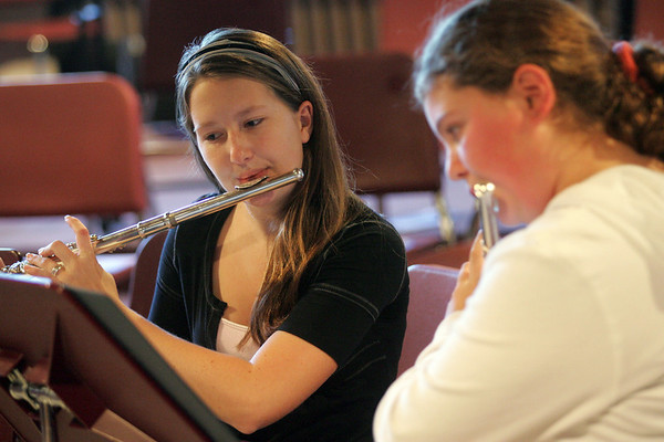 Rockport: Rockport junior Kristy Levick plays the flute with sixth grader Shannon Lally as part of the music mentor program after school Thursday afternoon. All sixth grade band students are paired up with a older student to mentor them and help them better their music skills.  Mary Muckenhoupt/Gloucester Daily Times