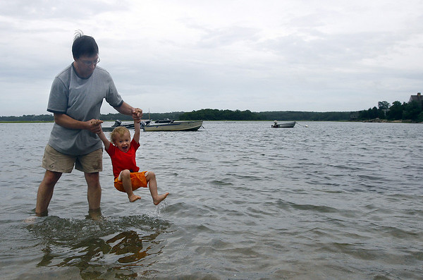 Essex: Peter Steele of Manchester swings his son Liam, 2, in the water off Conomo Point on Thursday afternoon. Peter says the point is Liam's favorite spot because the water is calm. Photo by Katie McMahon/Gloucester Daily Times Thursday July 24, 2008.  <br /> …5?