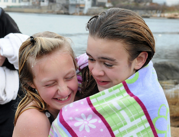 Gloucester: Thanksgiving Day swimmers Emily Wonson 12, and Rebecca Brackett 11, share a towel after their cold swim Thursday morning on Gilson Way, for the annual Thanksgiving Day Swim.52 Swimmers braved the cold water.Photo by Desi Smith/Gloucester Daily Times Thursday, November 27, 2008
