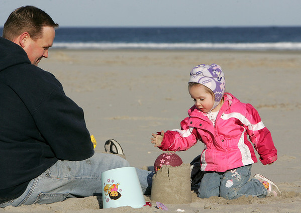 Gloucester:  Jenna Connelly, 2, plays in the sand with her dad Steve at Good Harbor Beach early Wednesday evening.  Jenna's parents tried to take her to the park but she insisted that she wanted to go to the beach.  <br /> Photo by Mary Muckenhoupt/Gloucester Daily Times Wednesday, April 02, 2008
