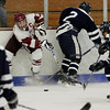 Gloucester: Gloucester's defenseman Paul Russo tries to gather the puck between Peabody forwards Matt Rodgers and Derek Pereira, right, during the hockey game at Dorothy Talbot Rink Wednesday night. Mary Muckenhoupt/Gloucester Daily Times