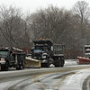 Gloucester: Snow plows sit of the Rt. 128 extension waiting to hit the street during the snow storm Saturday. Mary Muckenhoupt/Glouester Daily Times.