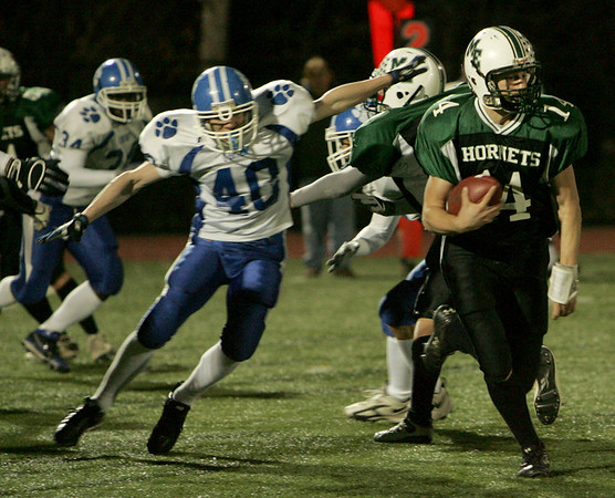 Manchester: Manchester Essex's Pat Orlando runs the ball during the Division 4 football playoff game against O'Bryant High School held at Reading High School Tuesday night.  Manchester Essex defeated O'Bryant 29-21. <br /> Photo by Mary Muckenhoupt/Gloucester Daily Times Tuesday, December 02, 2008