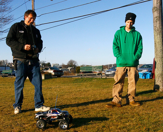 Gloucester: Rick Wood and his son, Tim, race a remote-controlled truck around Rocky Neck on Monday afternoon. The two bought two trucks on Saturday, but haven't been able to use them because of the rainy weather. Photo by Kate Glass/Gloucester Daily Times Monday, December 1, 2008