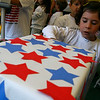 """Manchester: Lily Athenas, a student in Wendy Manninen's kindergarten class, casts her vote in the library at Manchester Memorial School during their """"mock election"""" yesterday. Photo by Kate Glass/Gloucester Daily Times Thursday, October 30, 2008"""