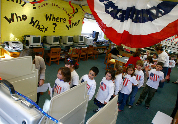 """Manchester: Students in Wendy Manninen's kindergarten class cast their vote in the library at Manchester Memorial School during their """"mock election"""" yesterday. Photo by Kate Glass/Gloucester Daily Times Thursday, October 30, 2008"""
