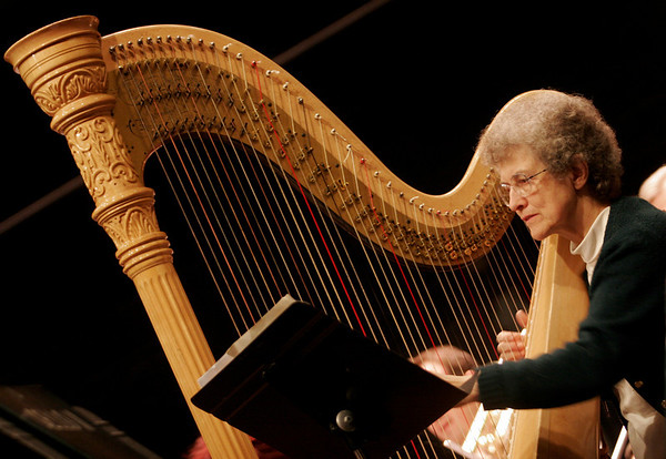 Gloucester: Judith Ross plays the harp in the Cape Ann Symphony during their rehearsal Tuesday night. The orchestra will kick off the holiday season with their annual Holiday POPS Concert on Saturday, November 29 at 8 p.m. and Sunday, November 30 at 2 p.m.