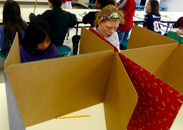 """Rockport: Yana Nash, left, and Maya Rowen, right, cast their ballots during Rockport Elementary School's """"Mock Election"""" on Wednesday. Nash voted for Obama because Hillary was out of the election, while Rowen voted for Obama because he is a democrat. Photo by Kate Glass/Gloucester Daily Times Wednesday, October 29, 2008"""