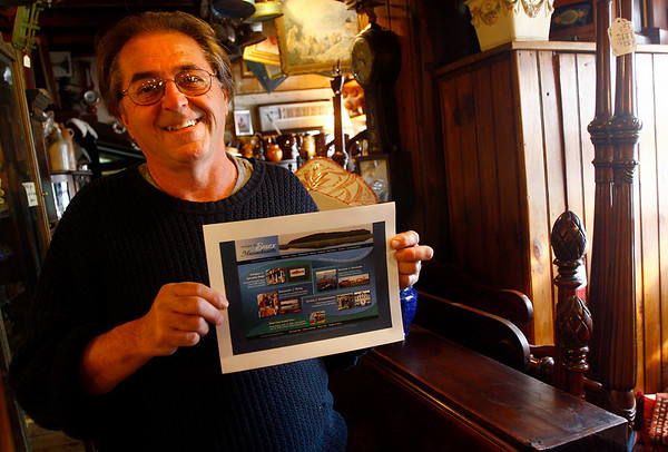 Essex: Bob Coviello of Main Street Antiques is working with the Essex Merchants Group to come up with a slogan for Essex. Photo by Kate Glass