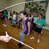 Manchester: Sara Stanton, 10, of Manchester jumps double dutch as the Beantown Jumpers, a double dutch team from Jamaica Plain, performed at the First Parish Chapel Saturday morning.  The jumpers gave a presentation and answered questions before teaching the kids how to double ducth. Mary Muckenhoupt/Gloucester Daily Times.