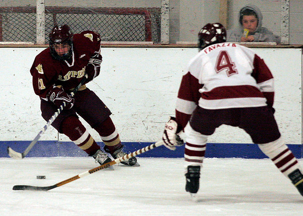 Gloucester: Newburyport's Ryan Cutter skates around Gloucester's Ben Favazza during their game at the Talbot Rink in Gloucester last night. Photo by Kate Glass/Gloucester Daily Times Tuesday, December 23, 2008
