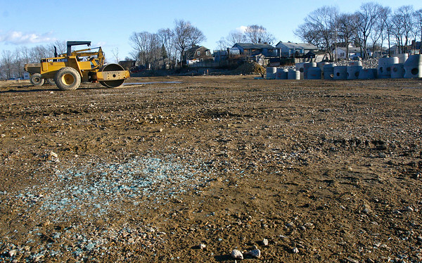 Gloucester: Broken glass is still strewn across the area where construction vehicles were vandalized at Gloucester Crossing over the holiday weekend. The damage caused McManus Excavating Co., Inc. over $7,000. Photo by Kate Glass/Gloucester Daily Times Tuesday, December 30, 2008