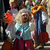 Rockport: Gracie Burbank heads down Main Street in Rockport as kids from Sandy Bay Preschool go on a Halloween parade Friday morning.  The kids stopped to trick-or-treat at some of the downtown businesses as they showed of their fun costumes. Mary Muckenhoupt/Gloucester Daily Times