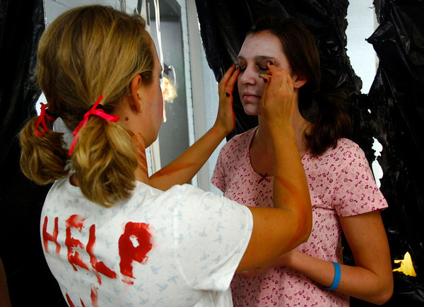 """Manchester: Alex Doyle helps Jen Bishop with her makeup at Manchester Essex's """"Haunted Hallways"""" on Wednesday. This year was the last year for the event since students are expected to be in the new building next year. Photo by Kate Glass/Gloucester Daily Times Wednesday, October 29, 2008"""